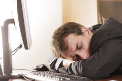 Businesman sleeping on workplace Stock Images
