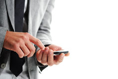 Businesman with a smart phone. Closeup of hands Stock Images