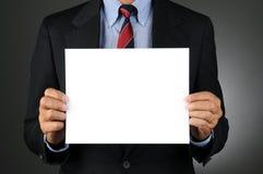Businesman som rymmer det blanka tecknet Arkivbilder