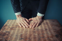 Businesman standing behind desk Stock Photo