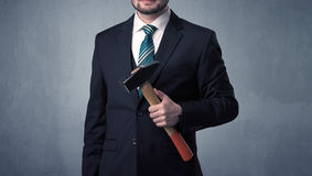 Businesman standing with tool on his hand Stock Photos