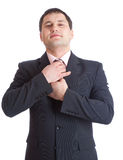 Businesman straighten one's tie Stock Photos
