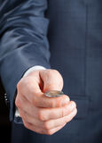 Businesman tossing a coin Royalty Free Stock Image