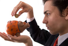 Businesman and your piggy bank Royalty Free Stock Photos