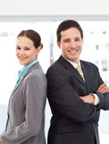 Businespeople posing back to back. Happy businessman and businesswoman posing back to back at work Royalty Free Stock Photo