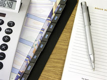 Daily Business. Calculator, dayplanner, pad and pen on a desk Royalty Free Stock Images