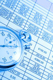 Business. Spreadsheet and Stopwatch in bluish light Royalty Free Stock Image