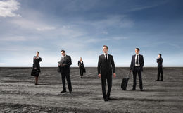 Business. Group of business people standing on a field Stock Image