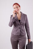 Business. Young woman on the phone with a mobile phone Stock Image