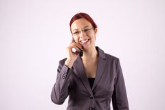 Business. Young woman on the phone with a mobile phone royalty free stock photo