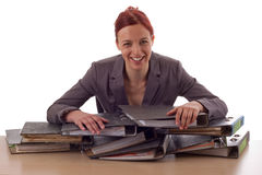 Business. Young woman and piles of files Stock Photo
