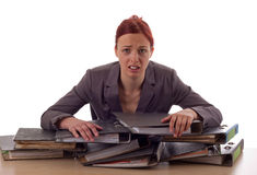 Business. Young woman and piles of files Royalty Free Stock Photography