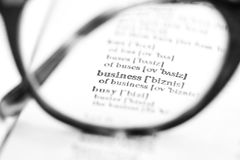 Business. The word business through the glasses Stock Images