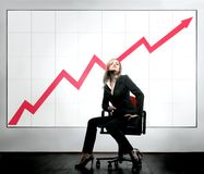 Business 18. A woman in office with a business diagram Stock Images