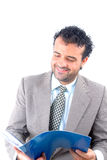 Business. Man smiling while reads a document Stock Image