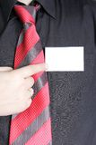 Business. The businessman points a finger at the card Stock Images