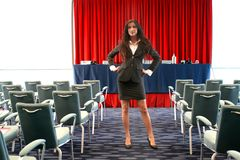 Business 25. A beautiful woman in a congress room Royalty Free Stock Images