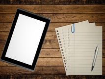 Business. Notebook, pen and tablet pc on wood table background. Business concept Stock Image