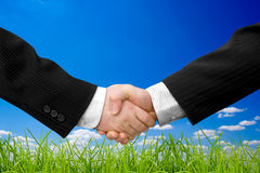 Business. Handshake with modern skyscrapers as background Stock Image