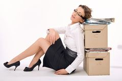 Business. Successful young businesswoman next to pile of documents, lots of copy space stock photography