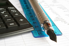 Business. Calculator and pen on a white background Stock Image