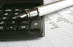 Business. Calculator and pen on a white background Stock Photography