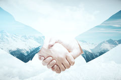 Business abroad. Closeup of handshake on abstract landscape background. Business abroad concept. Double exposure Royalty Free Stock Photo