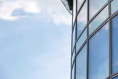 Business abstract - modern office building covered with glass ag Stock Photos