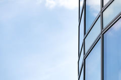 Business abstract - modern office building covered with glass ag Royalty Free Stock Image