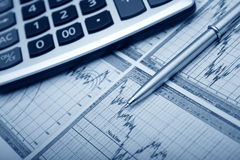 Business accessories. Graph, pen, calculator royalty free stock photo