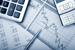 Business accessories. Graph, pen, calculator royalty free stock photography