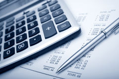 Business accessories. Graph, pen, calculator royalty free stock photos