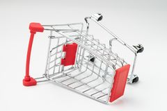 Business accident, product commerce fail or problem concept, clo. Sed up of crash red mini shopping cart, trolley on isolated white background Royalty Free Stock Images