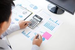 Business accountant or banker, businessman calculate and analysis with stock financial indices and financial costs wisely and car. Efully, investment and saving stock photography