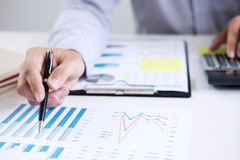 Business accountant or banker, businessman calculate and analysis with stock financial indices and financial costs wisely and car. Efully, investment and saving stock photo