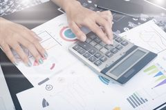 Business accountant with document graph making calculations royalty free stock photography