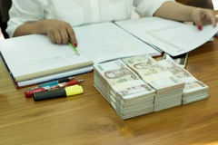 Business accountant working with documents with pile of Thai mon Royalty Free Stock Photos