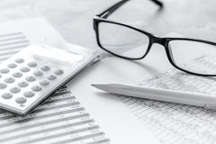 Business accounter work with taxes and calculator on office desk. Background Stock Photo