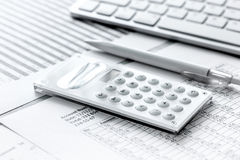 Business accounter work with taxes and calculator on office desk Stock Photo