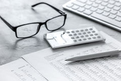 Business accounter work with taxes and calculator on office desk Royalty Free Stock Images