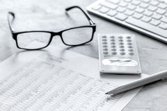 Business accounter work with taxes and calculator on white office desk Royalty Free Stock Image