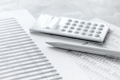 Business accounter work with taxes and calculator on white office desk. Background Royalty Free Stock Photo