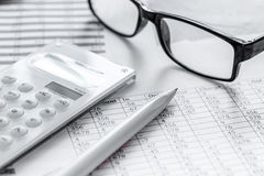 Business accounter work with taxes and calculator on white office desk. Background Royalty Free Stock Photography