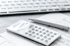 Business accounter work with taxes and calculator on white office desk. Background Stock Photography