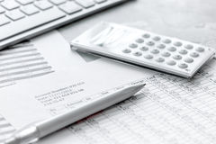 Business accounter work with taxes and calculator on white office desk Royalty Free Stock Photo
