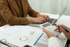 Using computers and calculators to work audit Work planning Checking account balance. stock photo