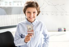 Delightful child is earning money Royalty Free Stock Image
