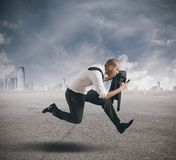 Business in action. Businessman running with mobile phone in hand Stock Photography