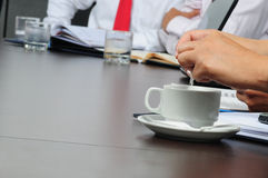 Business activities. Business people with paper work sitting in a boardroom Stock Photos