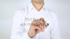 Business Administration, Man Writing on Glass, Handwritten. High quality stock photography